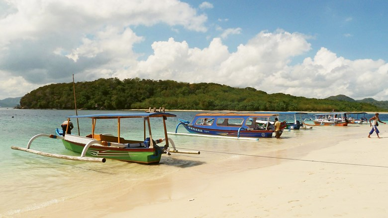 Boats on Gili Nanggu, among the small islands visited on a Star Clipper sailing in Indonesia.
