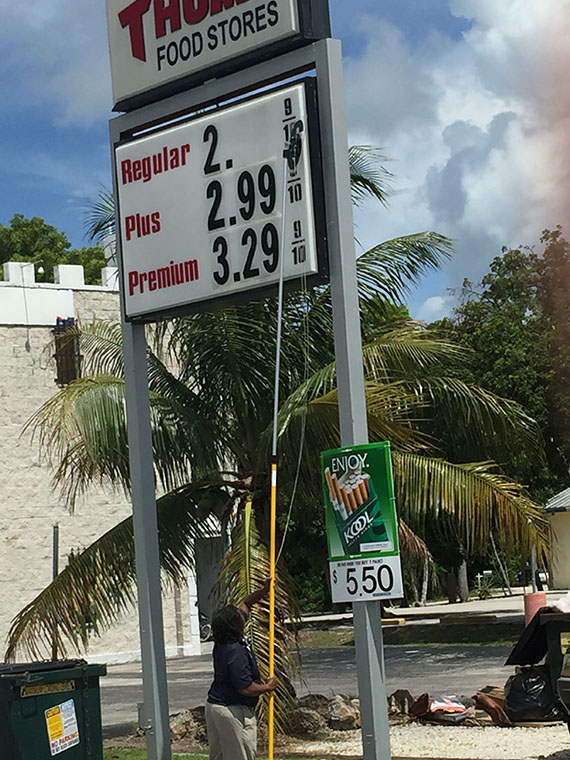 a worker takes the prices down at a tom thumb gas station in key largo on