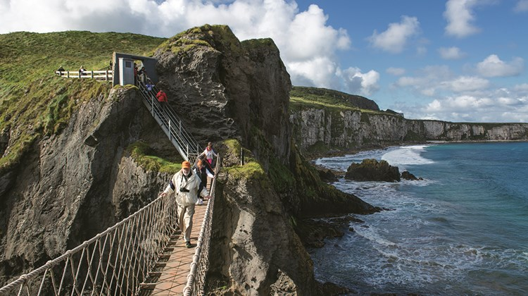 The popular Carrick-a-Rede rope bridge in County Antrim connects the mainland to a small island once used by fishermen.<br /><br /><strong>Photo Credit: Arthur Ward/Tourism Ireland</strong>