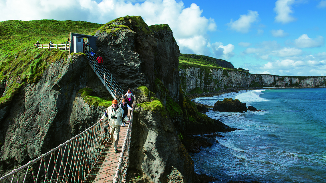 The popular Carrick-a-Rede rope bridge in County Antrim connects the mainland to a small island once used by fishermen. Photo Credit: Arthur Ward/Tourism Ireland