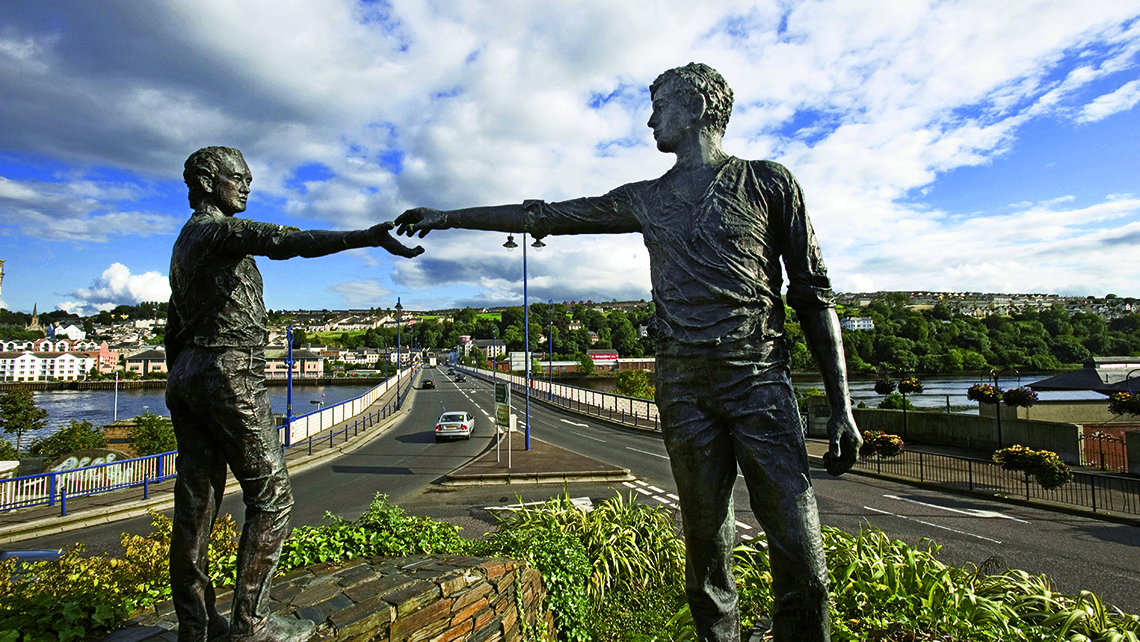 The bronze Hands Across the Divide sculpture in Derry. Photo Credit: Christopher Hill/Tourism Ireland