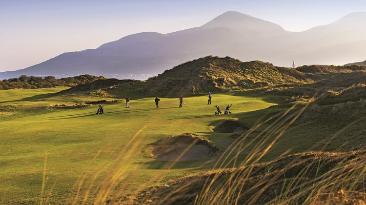 Royal County Down Golf Club, set against the Mourne Mountains, home to Northern Ireland&#39;s highest peaks.<br /><br /><strong>Photo Credit: Brian Morrison/Tourism Ireland</strong>