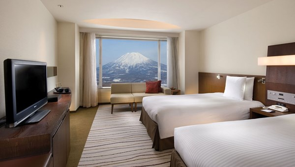 A guestroom at the 506-room Hilton Niseko Village, which overlooks Mount Yotei.