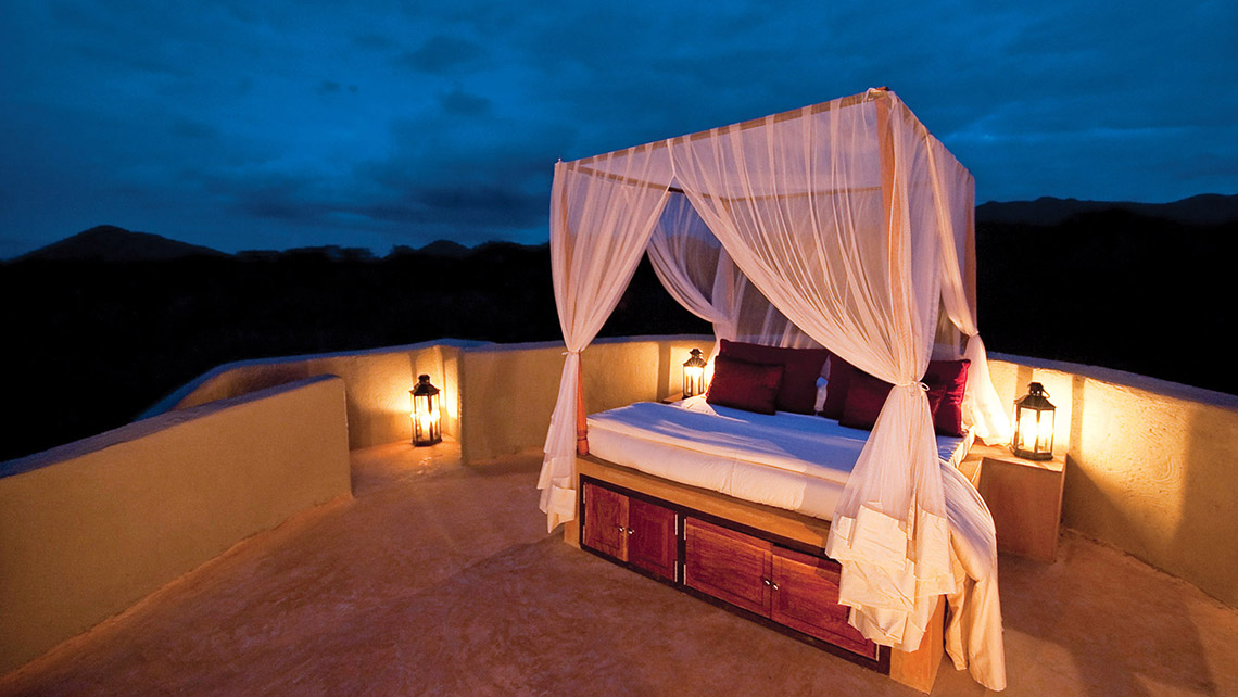 An open-air star bed at Ol Donyo Lodge, a Relais & Chateaux property. Photo Credit: Courtesy of Great Plains