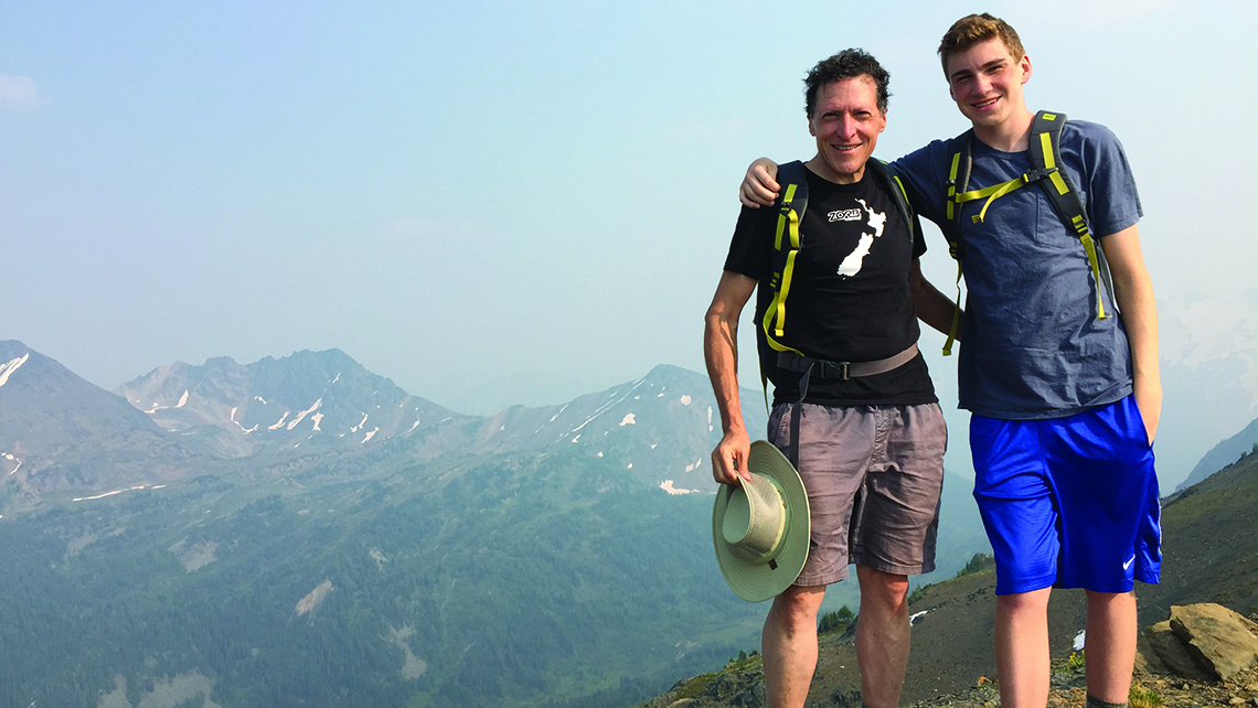 The writer and his 16-year-old son commemorate reaching the highest point of a challenging hike with a photo. Photo Credit: TW photo by Arnie Weissmann
