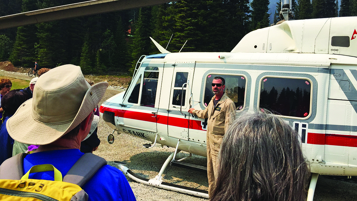 Hikers get a briefing on helicopter protocol and safety from pilot Matt Ellis before the first ride. Photo Credit: TW photo by Arnie Weissmann