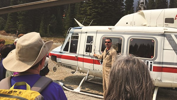Hikers get a briefing on helicopter protocol and safety from pilot Matt Ellis before the first ride.