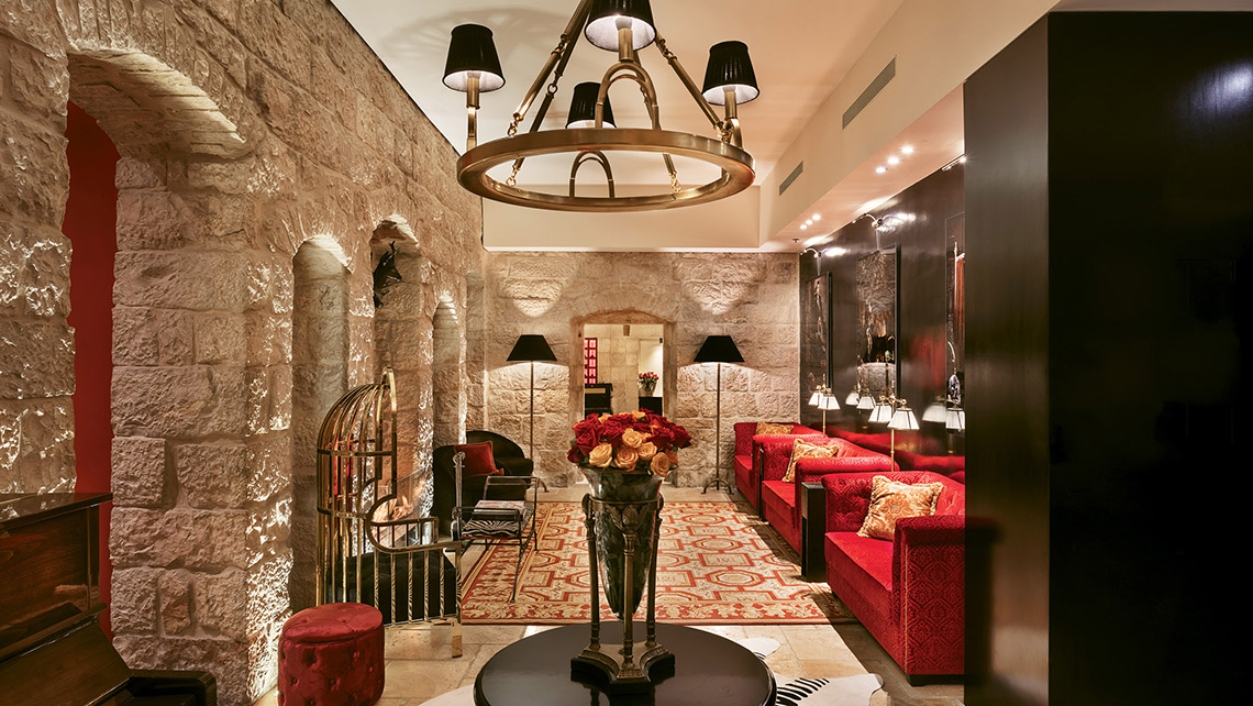 The lobby of the Villa Brown Jerusalem. The walls of exposed stone are over 100 years old. Photo Credit: Assaf Pinchuk