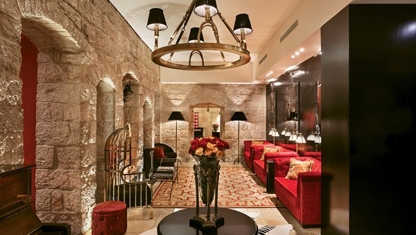 The lobby of the Villa Brown Jerusalem. The walls of exposed stone are over 100 years old.