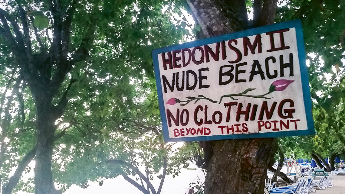 A nude beach sign lets guests know what's in store beyond that point at Hedonism II.