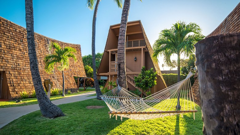Hotel Molokai is made up of 12 Polynesian-style bungalow buildings with private patios and balconies steps away from a reef-lined beach.