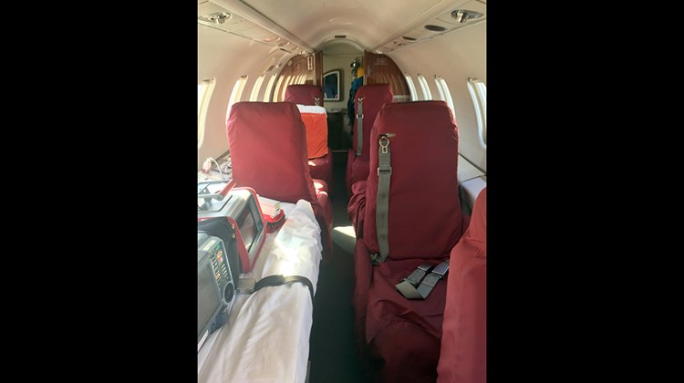 Upon entering the plane, the cockpit is to the left. To the right are passenger seats (this jet was equipped with six) and a stretcher.