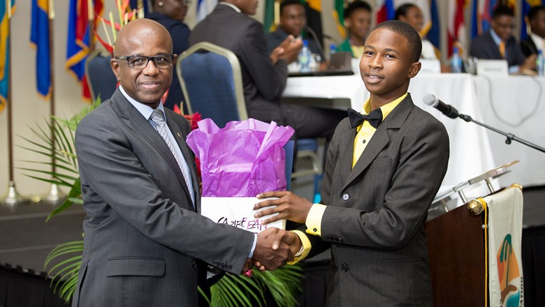 Hugh Riley, CTO's secretary general with Francis Alexander, winner of the Youth Congress competition at CTO's State of the Industry Conference in Grenada last week.
