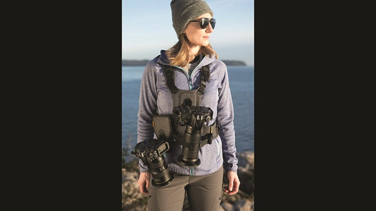 A vest carrier that distributes the weight of a camera ergonomically, the CCS G3 Camera Harness System can support and accommodate a camera and a long lens. It boasts a quick-release waist belt, two front pockets for carrying small items and a large pocket on the back. A patented Twist&Lock mount system keeps the equipment secure but always at the ready. A lens hold-down strap, which formerly was secured by Velcro, now has a quieter snap closure.
