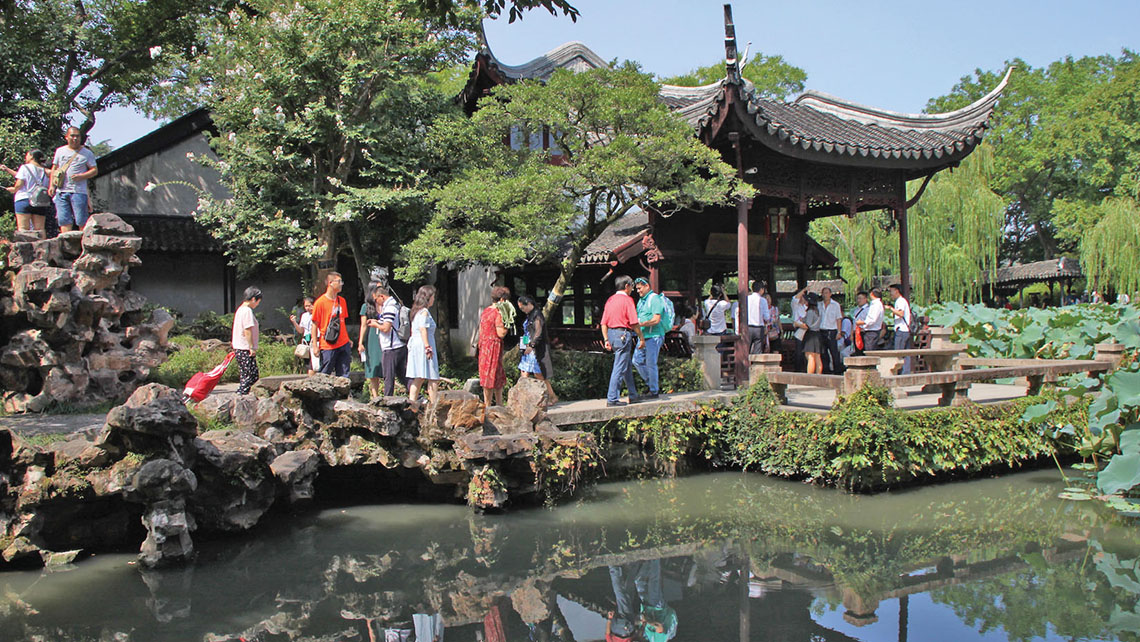 Suzhou's gardens, most dating to the Ming and Qing dynasties, incorporate natural and man-made elements to create deliberate scenes akin to works of art. Photo Credit: Nadine Godwin