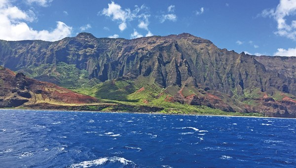 A boat tour is the ideal way to take in the awe-inspiring beauty of the Na Pali Coast. Spotting dolphins, snorkeling and sipping onboard mai tais are a pleasant bonus.