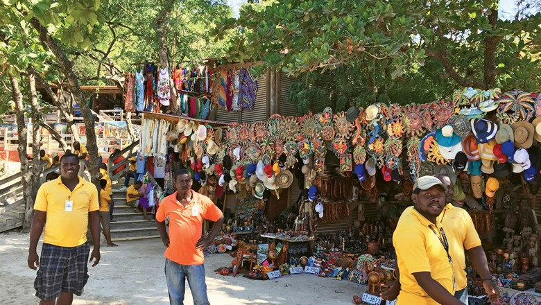 Vendors at the Artisan's Market in Labadee, where storefronts overflow with clothes, wood carvings, jewelry and more.