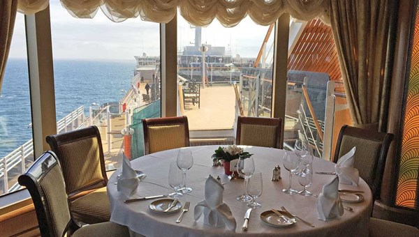 A table in the Queens Grill on Cunard Line's Queen Victoria, which offers a sweeping view.