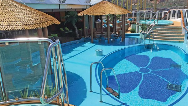 In the Havana Cabana section onboard the Carnival Vista, guests have exclusive access to an aft pool area and a promenade. Carnival is expanding the 61-cabin exclusive section on the Horizon, due next year.