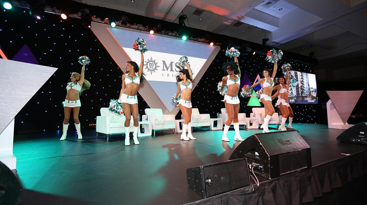 The Miami Dolphins cheerleaders open Thursday morning&#39;s breakfast, sponsored by MSC Cruises. Day 2 of the CruiseWorld conference included more agent-focused informational sessions, a panel discussion with cruise presidents and an exhibitor showcase.<br /><br /><strong>Photo Credit: Creative Focus</strong>