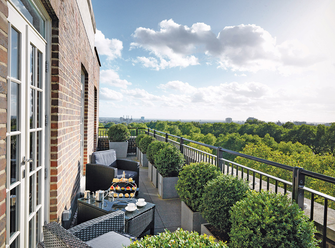 The verdant view of Hyde Park from a balcony at Jumeirah's Grosvenor House Suites in London.