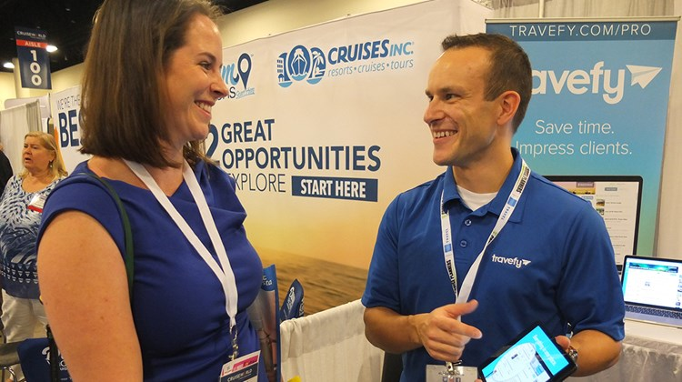 Travefy&#39;s Scott Rutz explains his product to Rebecca Vogt, an agent with the Cruise Captain based in Tampa.<br /><br /><strong>Photo Credit: TW photo by Jamie Biesiada</strong>