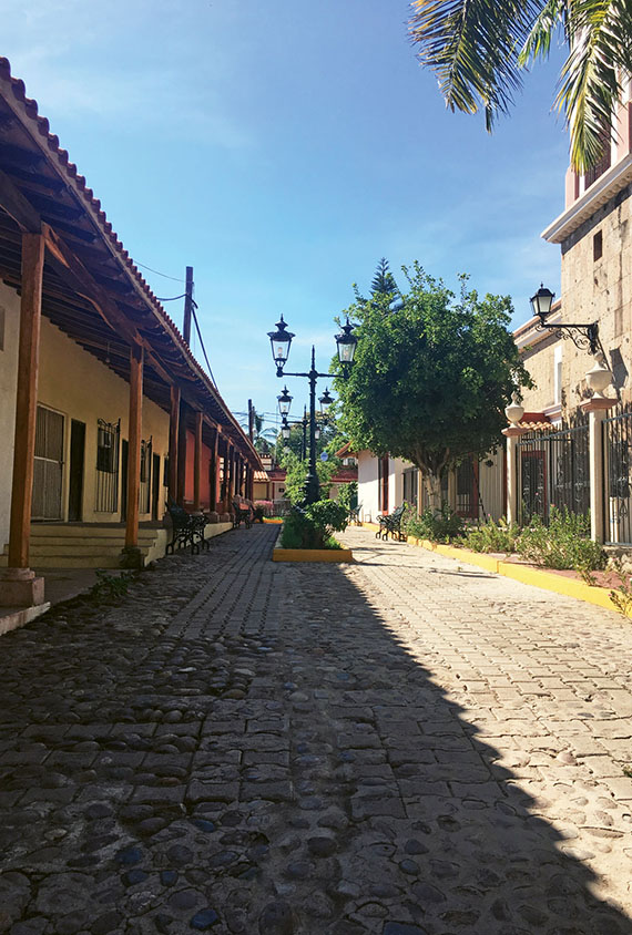A street in El Quelite, with its red-tile roofs, pastel-colored colonial architecture and cob-blestone streets.