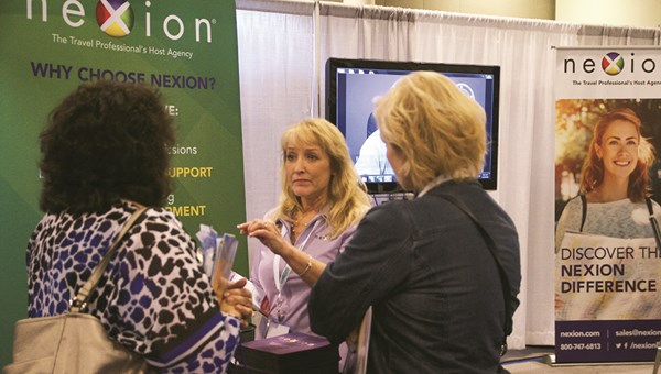 Nexion representative Wendy Graziano meeting with agents during Travel Weekly's CruiseWorld in 2016.