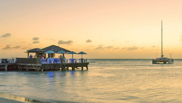 Piet's Pier Bar at the Hyatt Regency Aruba is a great place to catch the sunset on Palm Beach.