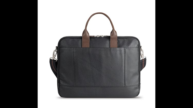 Just the thing for the earnest business traveler, the Shorewood Leather Briefcase is as practical as it is good looking. Among its attributes are a full-grain pebble leather exterior, a fully padded 15.6-inch laptop compartment, an internal tablet pocket, two front pockets, a front-zippered pocket with an organizer and key clip, a heavy twill lining, metal hardware and a removable, adjustable shoulder strap. One extra convenience: a back panel that slides over a luggage handle for easy airport transport.