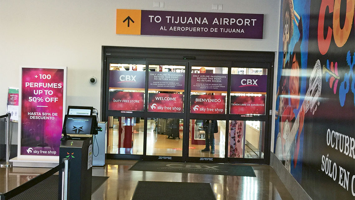 A customs station outside a duty-free shop at the CBX terminal. Photo Credit: Robert Silk