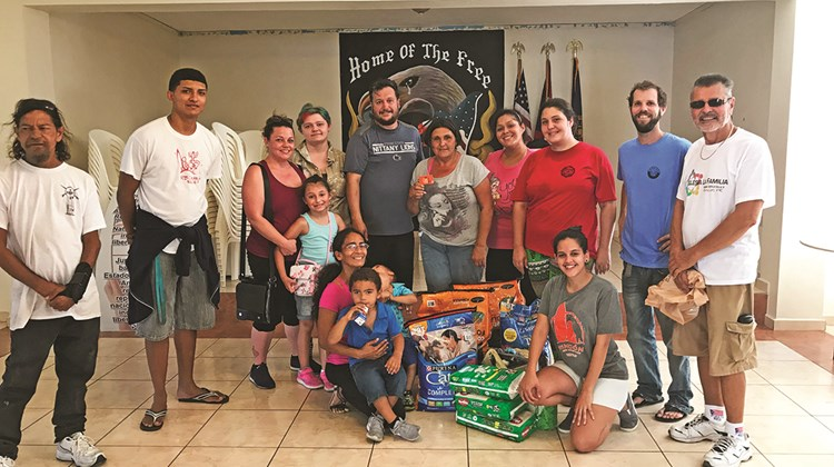 The Dejesus family from Nebraska dropping off donations at the Rincon Beer Co. in Puerto Rico.<br /><br /><strong>Photo Credit: TW photo by Johanna Jainchill</strong>