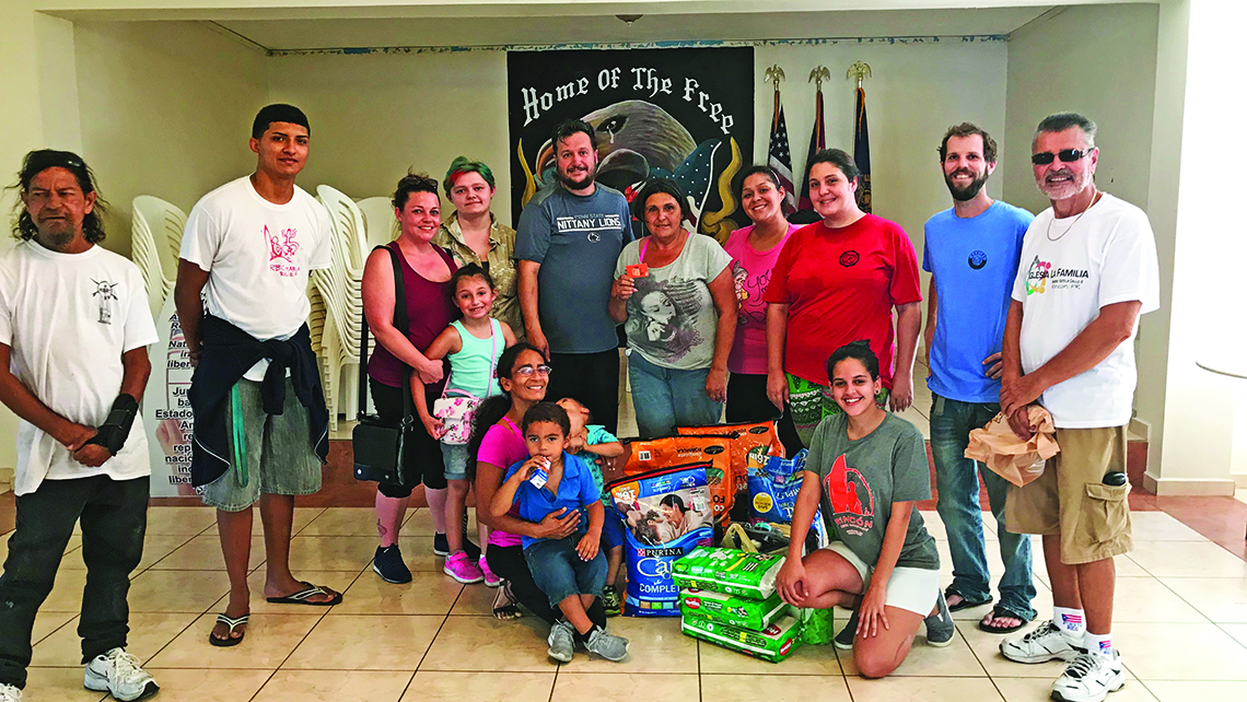 The Dejesus family from Nebraska dropping off donations at the Rincon Beer Co. Photo Credit: TW photo by Johanna Jainchill
