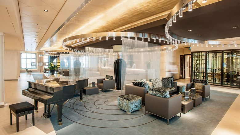 The atrium and piano bar where passengers embark the redesigned Europa 2 has a spacious feel.