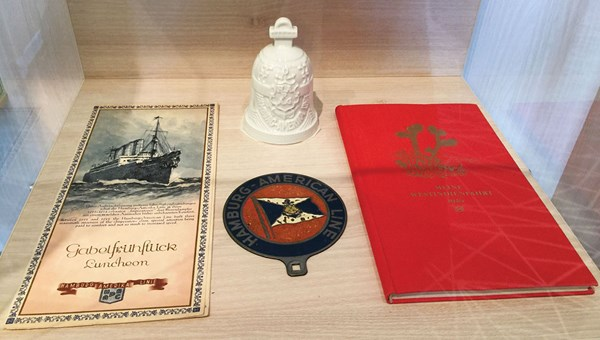 Hapag-Lloyd historical items on display in the sales center.