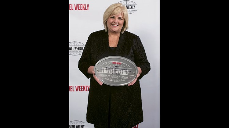 Delta's Kristen Shovlin. The airline won Readers Choice Awards in the Domestic, Sales & Service and Overall categories.
