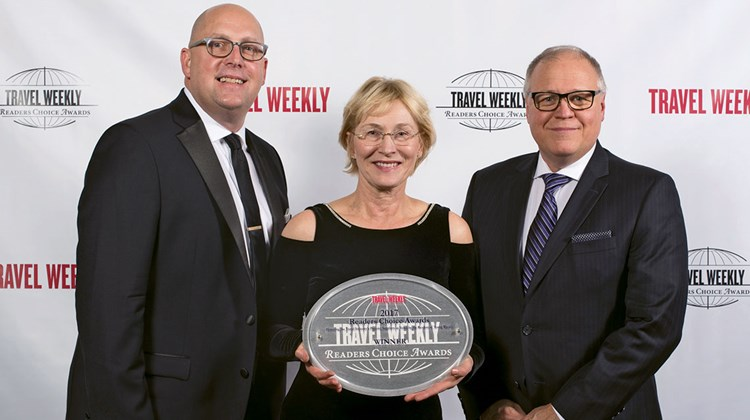 Jeff Bont, Inna Germanotta and Jonathan Hope of Rocky Mountaineer, winner for Rail Vacation.