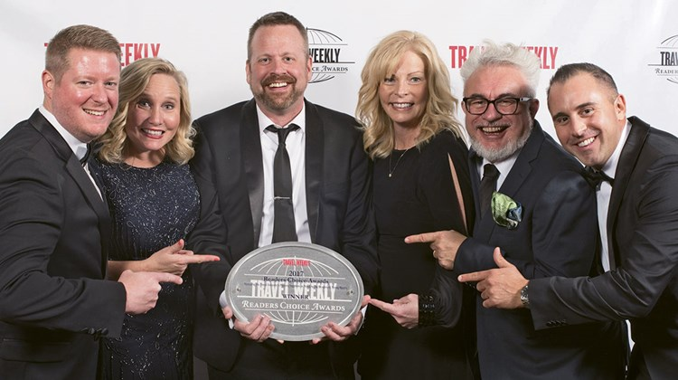 Kevin McCullough, Tracee Adams, John Van den Heuvel, Kelly Koehler, Dean Smith and Brennan Quesnele with Gogo Vacations, which got the nod for the Group Packaged category.
