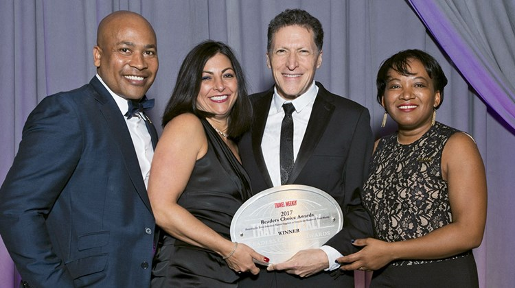 Travel Weekly's Arnie Weissmann, second from right, with Sebastian Maureschal, Pauline Pigott and Nicole Barrett of Sandals, which won in the Caribbean and All-Inclusive categories.