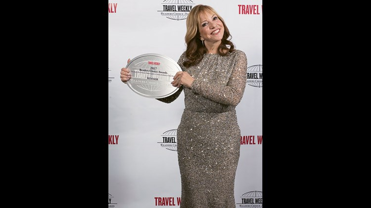 Vicki Freed of Royal Caribbean International, which won for Overall Cruise Line, Overall Individual Cruise Ship (for the Harmony of the Seas), Caribbean, Sales & Service and Entertainment.