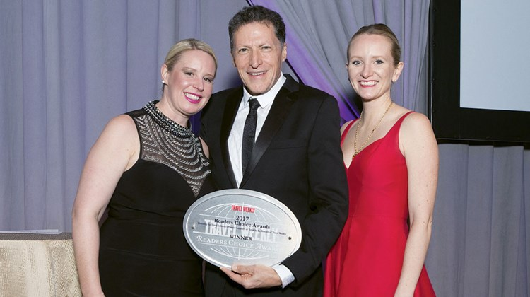 Jaclyn Leibl-Cote and Diana Ditto of Collette with Travel Weekly's Arnie Weissmann. Collette won top Canada tour operator.