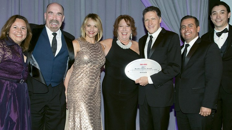 Travel Weekly's Arnie Weissmann (third from right) with, from left, Martha Troncoza, Michael Weldon, Ana Parodi, Michele Saegesser, Erik De La Cruz and Michael Eng of Viking Cruises. Viking repeated its wins in the River Cruising and River Cruise Sales & Service categories.