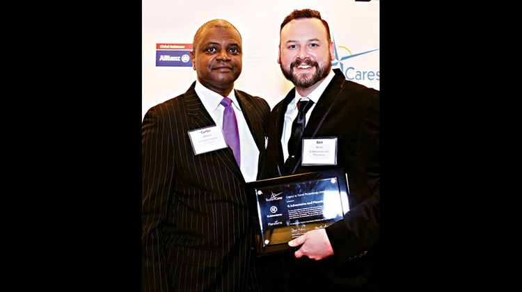 Ben Perlo, right, of G Adventures and Planeterra and Curtis Wilson of American Express. G Adventures and Planeterra were recognized with a Legacy in Travel Philanthropy Award for their $8 million in charitable contributions and the 50 in 5 campaign, aimed at creating 3,000 jobs for marginalized women, at-risk youth and indigenous populations.