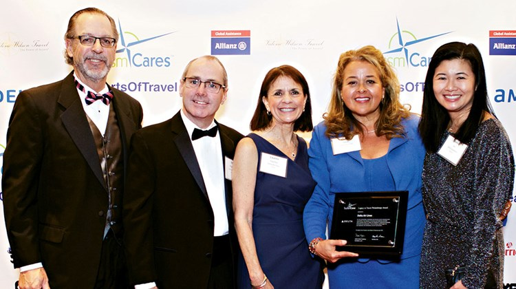 "Tourism Cares honored Delta with a Legacy in Travel Philanthropy Award, citing its ""tremendous commitment to community, a direct reflection of their culture and values."" From left: Steve Diggelmann of Delta Vacations; Jim Magrath, Lauren Faucher and Norma Dean of Delta Air Lines; and Jennie Ho of Delta Vacations."