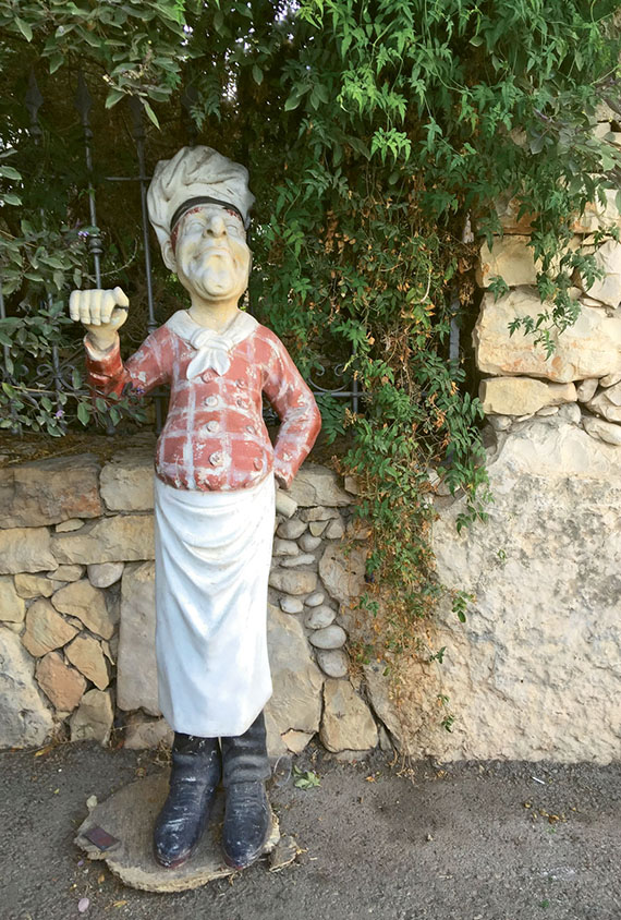 A chef statue greets diners at Abu Gosh restaurant on the square. With plenty of cultural and beach activities, Tel Aviv is ideal for multigenerational travel.