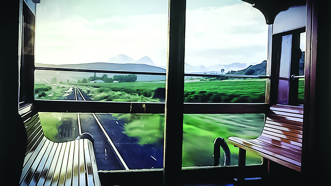 The highlight of a Rovos Rail journey is watching the scenery whiz by from the simple wooden benches in the open-air balcony of the observation car.