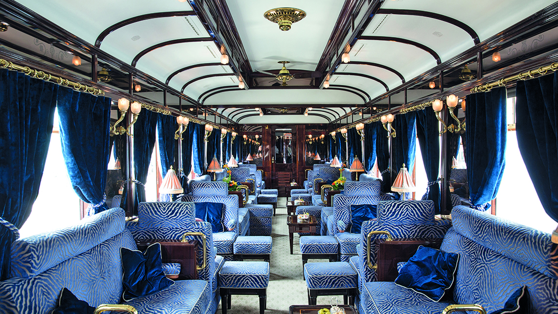 The lushly appointed bar car on the Venice Simplon-Orient-Express includes a piano.