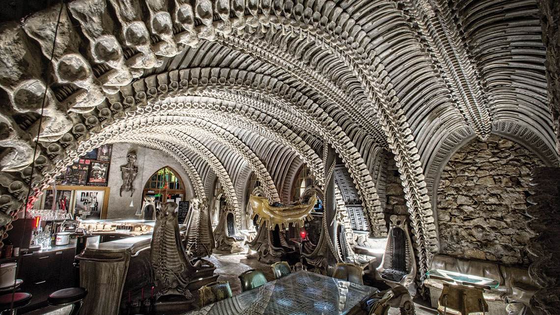 "The H.R. Giger Bar in Gruyeres, Switzerland, is one of the stops on VeryFirstTo's ""World's Most Alluring Secret Bars"" trip."