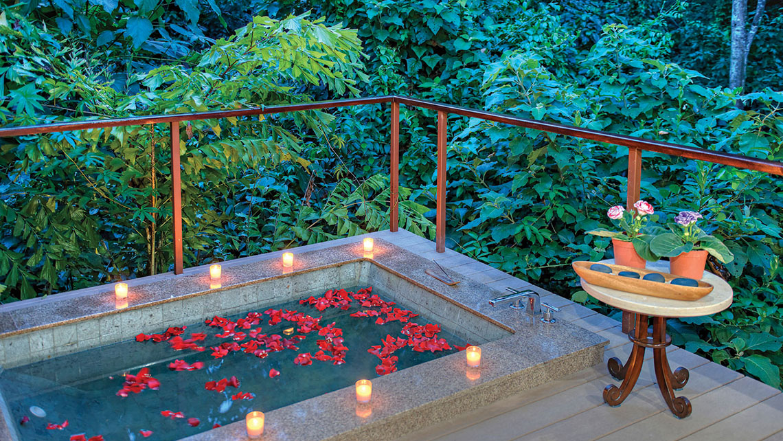 A rose-petal-infused whirlpool tub in a treatment bungalow in the hotel's highly regarded spa, which is shared with the neighboring Nayara Resort, Spa & Gardens.