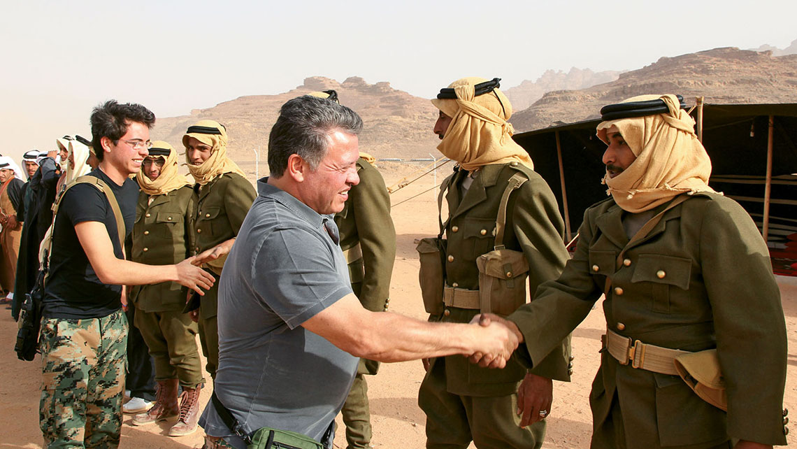 In Wadi Rum, King Abdullah II and Crown Prince Hussein meet actors portraying soldiers in a re-enactment of the Great Arab Revolt of 1916. Photo Credit: Courtesy Royal Hashemite Court